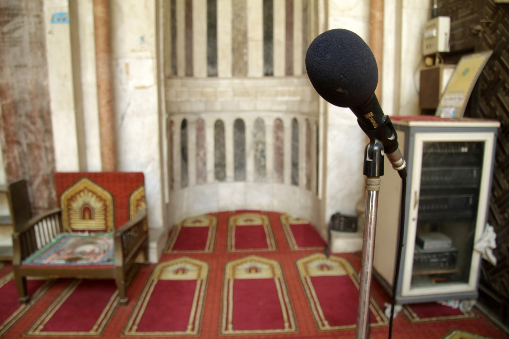 Muezzin's empty microphone with PA system and wireless receiver in the background (upper right). Photographer: Anna Kipervaser © 2012 On Look Films, LLC. All Rights Reserved.